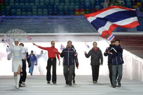 Thailand's flag bearer, alpine skier Kanes Sucharitakul leads his national delegation during the Opening Ceremony of the Sochi Winter Olympics at the Fisht Olympic Stadium on February 7, 2014 in Sochi