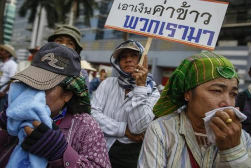 Farmer protesters cry during a rally demanding the Yingluck administration resolve delays in payment, outside Government's temporary headquarters in Bangkok