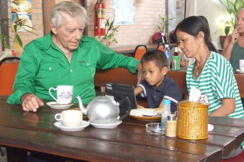 Raymond O'Prey, 72, his wife Jamriang, 50, and her biological grandson Mick, 8, in Thailand.