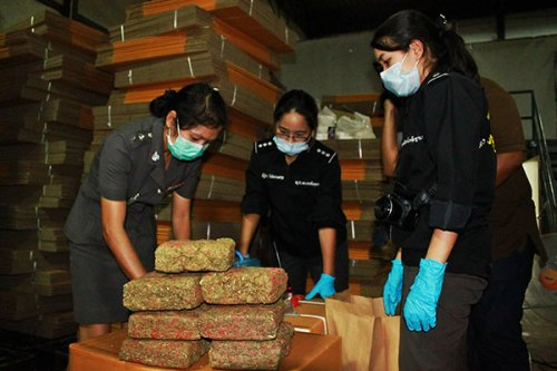 Officials inspect the seized block cannabis found in a warehouse in Pathum Thani. (Video by Apichit Jinakul and photos by Pongpat Wongyala)