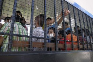 Suspected Uighurs are transported back to a detention facility in the town of Songkhla in southern Thailand
