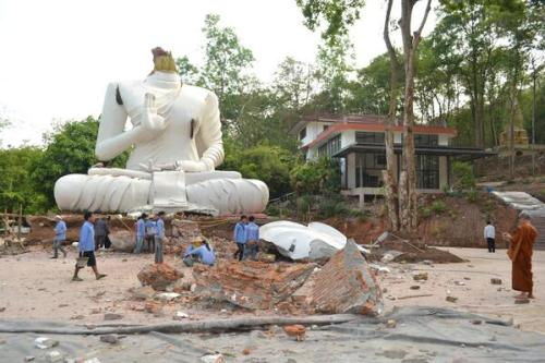 A Buddha statue, damaged by an earthquake, is seen at the Udomwaree temple in Chiang Rai