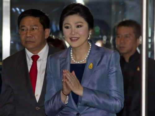 Thailand's Prime Minister Yingluck Shinawatra, center, arrives at the Constitutional Court in Bangkok, Thailand, Tuesday, May 6, 2014.
