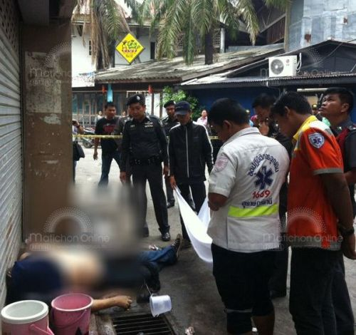 Police at the scene of Schwartges Volker's stabbing in Chaweng Beach