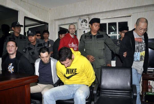 The suspects before their extradition from Thailand.