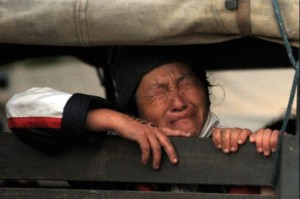 An Ethnic Hmong refugee sits inside a police truck during the operation to deport thousands of Hmong to Laos near the ethnic Hmong refugee camp in Huay Nam Khao in northern Phetchabun province on December 28, 2009. The camp's closure has left Hmong — who sided with the US during the Vietnam War era — facing detention, torture, or life on the run.