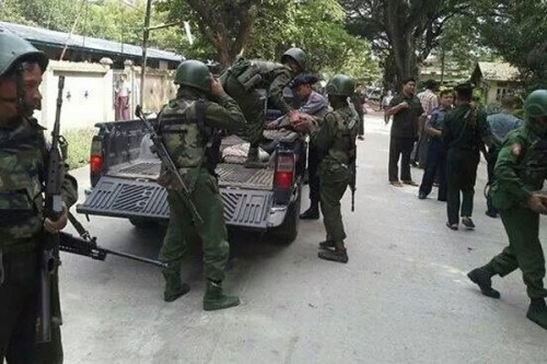 Myanmar soldiers prepare reinforcements for a battle near Myawaddy on Saturday Please credit and share this article with others using this link:http://www.bangkokpost.com/news/local/434611/new-fighting-in-karen-territory. View our policies at http://goo.gl/9HgTd and http://goo.gl/ou6Ip. © Post Publishing PCL. All rights reserved.