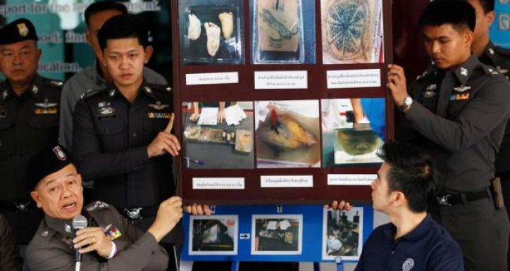 Police show pictures of body parts found in parcels. A baby's head and foot, a heart and a tattooed 'sheet of skin' were found on Saturday after staff at a shipping office in Bangkok scanned the packages. Photograph: Chaiwat Subprasom
