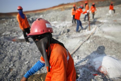 Miners take a break from work at the Chatree gold mine operated by Akara Mining in Phichin
