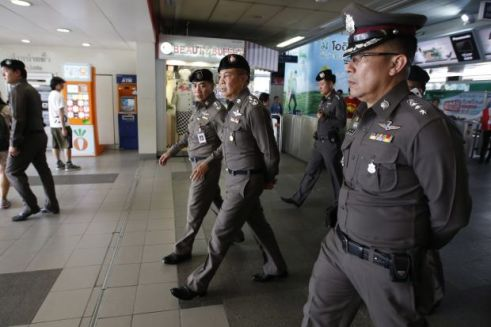 Thai police and soldiers patrol Skytrain stations and shopping centers searching for protesters in Bangkok