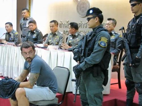 Xavier Andre Justo, a former employee of PetroSaudi, is seen at a police press conference after his arrest on Koh Samui