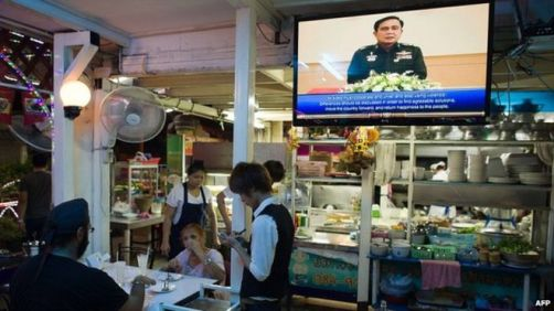 Locals watch Prayuth Speaking on his weekly Returning Happiness to Thai People broadcast