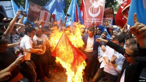Protests in Turkey have seen Chinese flags being burned at the weekend
