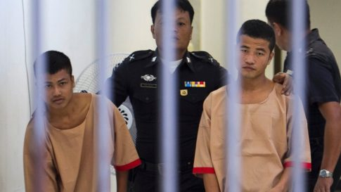Myanmar migrants Win Zaw Htun, right, and Zaw Lin, left, both 22, are escorted by officials after their guilty verdict at court in Koh Samui, Thailand, Thursday, Dec. 24, 2015