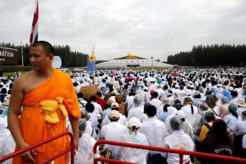 A buddhist monk and followers gather inside the Wat Phra Dhammakaya temple complex in anticipation of a planned police raid, in Pathum Thani province, north of Bangkok, Thailand, June 16, 2016. REUTERS/Athit Perawongmetha