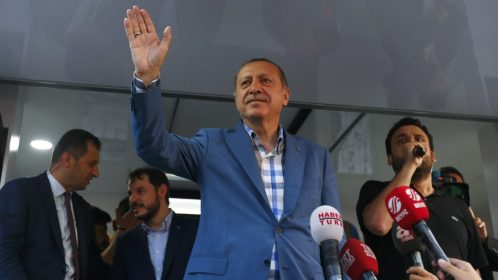 Turkish President Tayyip Erdogan delivers a speech to his supporters in Istanbul, Turkey