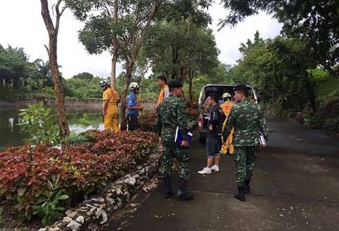 Rescue Team at site where villagers found Gao washing her clothes on the bank of a canal.