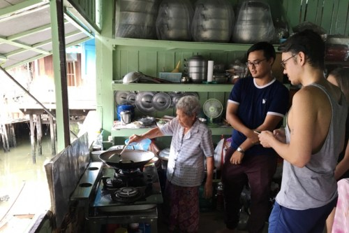 Their guide's own grandmother whips up some pad thai for tourists at TakeMe Tour. Photo/TakeMeTour