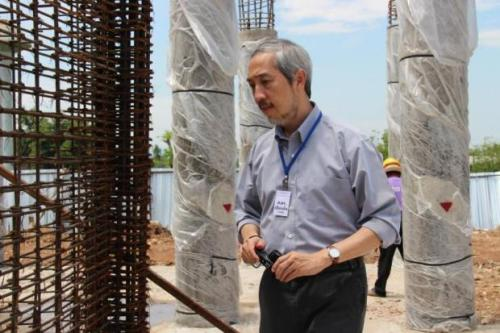Dr. Pennung Warnitchai inspects a construction site in Chiang Rai to ensure its structural strength and whether it can withstand a further earthquake