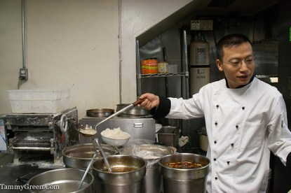 Tony Hu serving soup