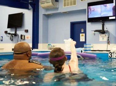 Video playback swimming lessons | Chicago Blue Dolphins
