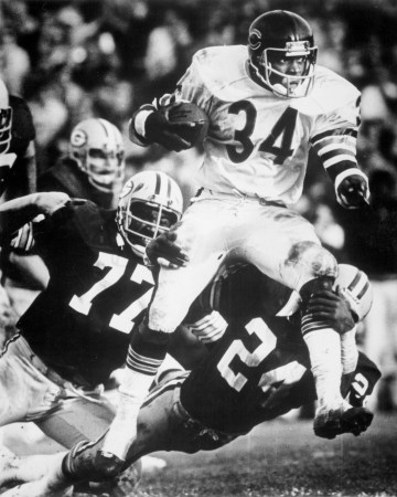 Walter Payton breaking a tackle from the GB Packers