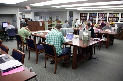 Patrons seated at tables in the Research Center