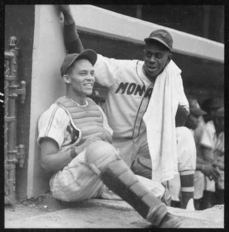 Satchel Paige (right, with towel) talking to unknown catcher, Chicago, August 2, 1955. CHM, ICHi-052257; photograph by Arthur Siegel