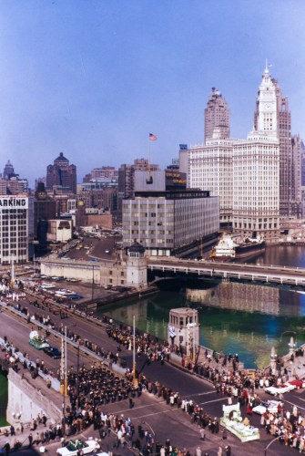 Birds-eye view of the St. Patrick's Day parade and dyeing of the Chicago River in Chicago, 1962.