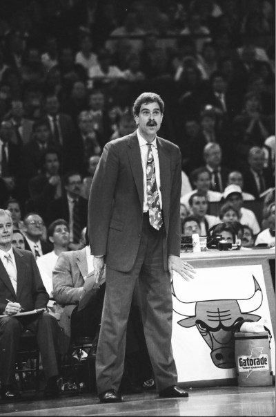 Coach Phil Jackson stands on the sidelines