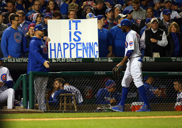 Oct 22, 2016; Chicago, IL, USA; Chicago Cubs fans hold up a sign as center fielder Dexter Fowler (24) walks back to the dugout during the fourth inning of game six of the 2016 NLCS playoff baseball series against the Los Angeles Dodgers at Wrigley Field. Mandatory Credit: Jerry Lai-USA TODAY Sports