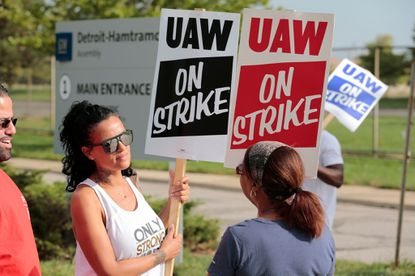 GM and UAW reach tentative deal that may end strike