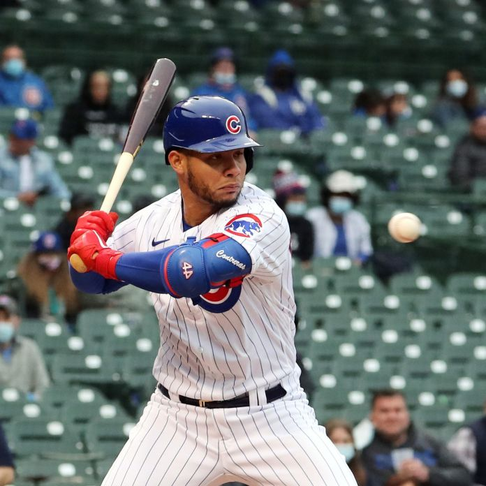 Chicago Cubs catcher Willson Contreras looks at ball four thrown by Los Angeles Dodgers pitcher Dennis Santana in the second inning of the first game of split doubleheader at Wrigley Field on May 4, 2021.