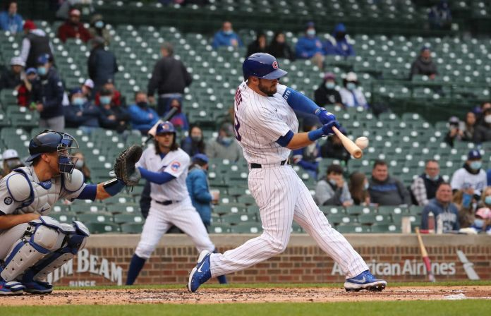 Chicago Cubs second baseman David Bote (13) hits a three-run double in the first inning of the first game of split doubleheader at Wrigley Field on May 4, 2021.