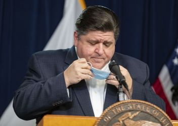 Commentary: Why it matters when Gov. J.B. Pritzker wears a mask ...