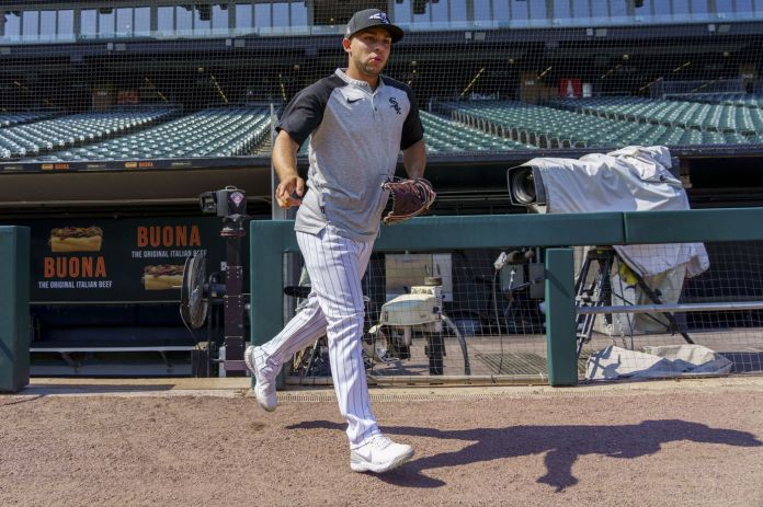 Chicago White Sox second baseman Nick Madrigal runs on the field for warmups before a game against the Toronto Blue Jays at Guaranteed Rate Field on June 8, 2021.