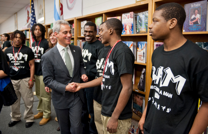 Mayor Rahm Emanuel announced new investments in mentoring, after-school and summer programs at Harper High School, 6520 S. Wood St. Feb. 7, 2013. He greeted Marcus Norris, 16, and other members of Becoming A Man (BAM), a program for at-risk youth. | Rich Hein~Sun-Times