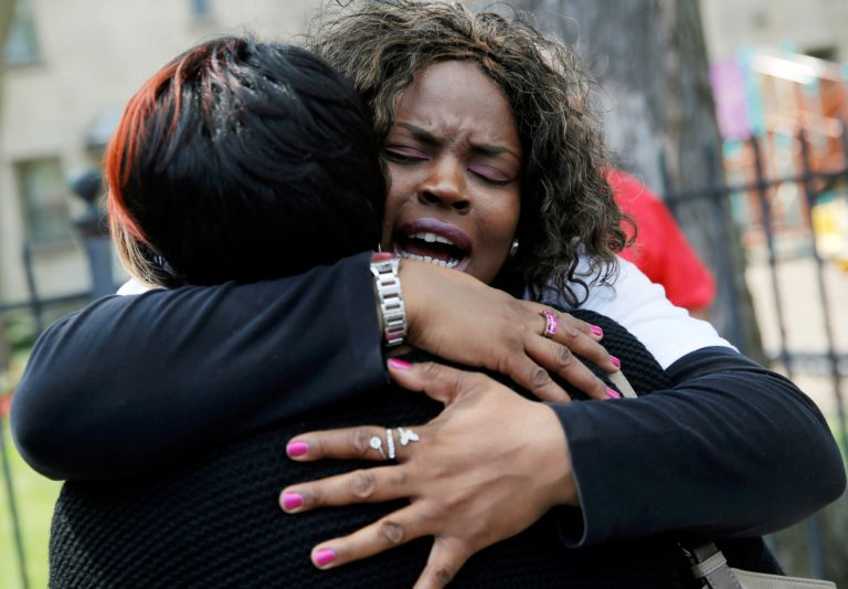 """Nortasha Stingiey (R) hugs Lutrice Boyd during a news conference by """"Purpose over Pain"""", a group of mothers who lost children to gun violence, calling for a stop to shootings in Chicago, Illinois, United States, May 6, 2016.REUTERS/Jim Young  - RTX2D6H1"""
