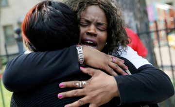 "Nortasha Stingiey (R) hugs Lutrice Boyd during a news conference by ""Purpose over Pain"", a group of mothers who lost children to gun violence, calling for a stop to shootings in Chicago, Illinois, United States, May 6, 2016.REUTERS/Jim Young  - RTX2D6H1"