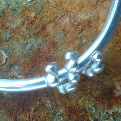 Silver bangle with pebble curl - Sterling silver