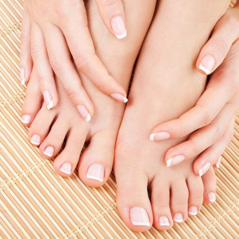 Pretty nails on hands and feet together