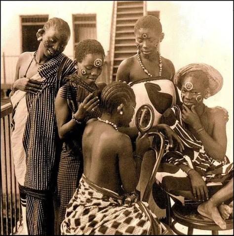 Swahili Zanzibari Girls Braiding Hair into Simple Plaits
