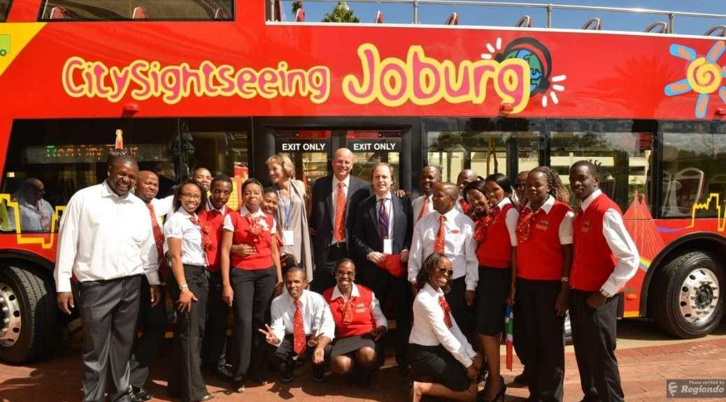 Johannesburg hop on hop off tour:City Sightseeing Joburg bus with staff