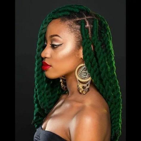 Chunky green twisted braids on dark skin