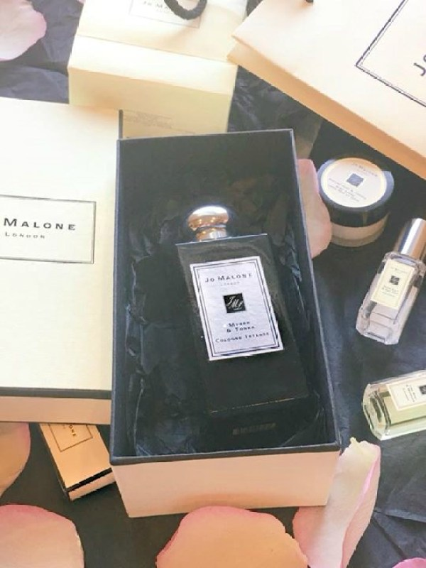 A black Jo Malone fragrance bottle