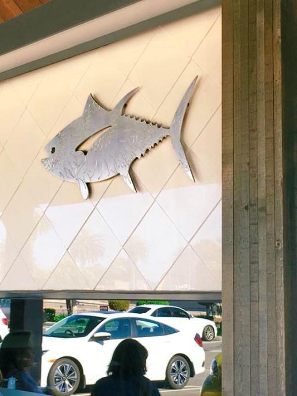 A sugar fish sign outside their restaurant