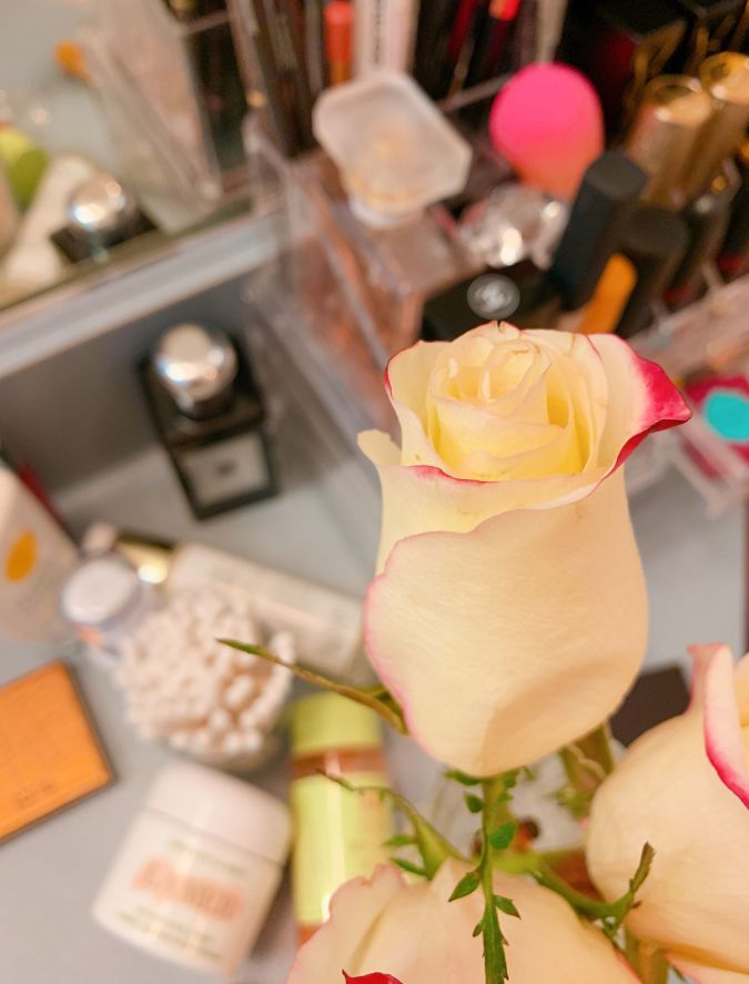 A flower on top of a makeup station