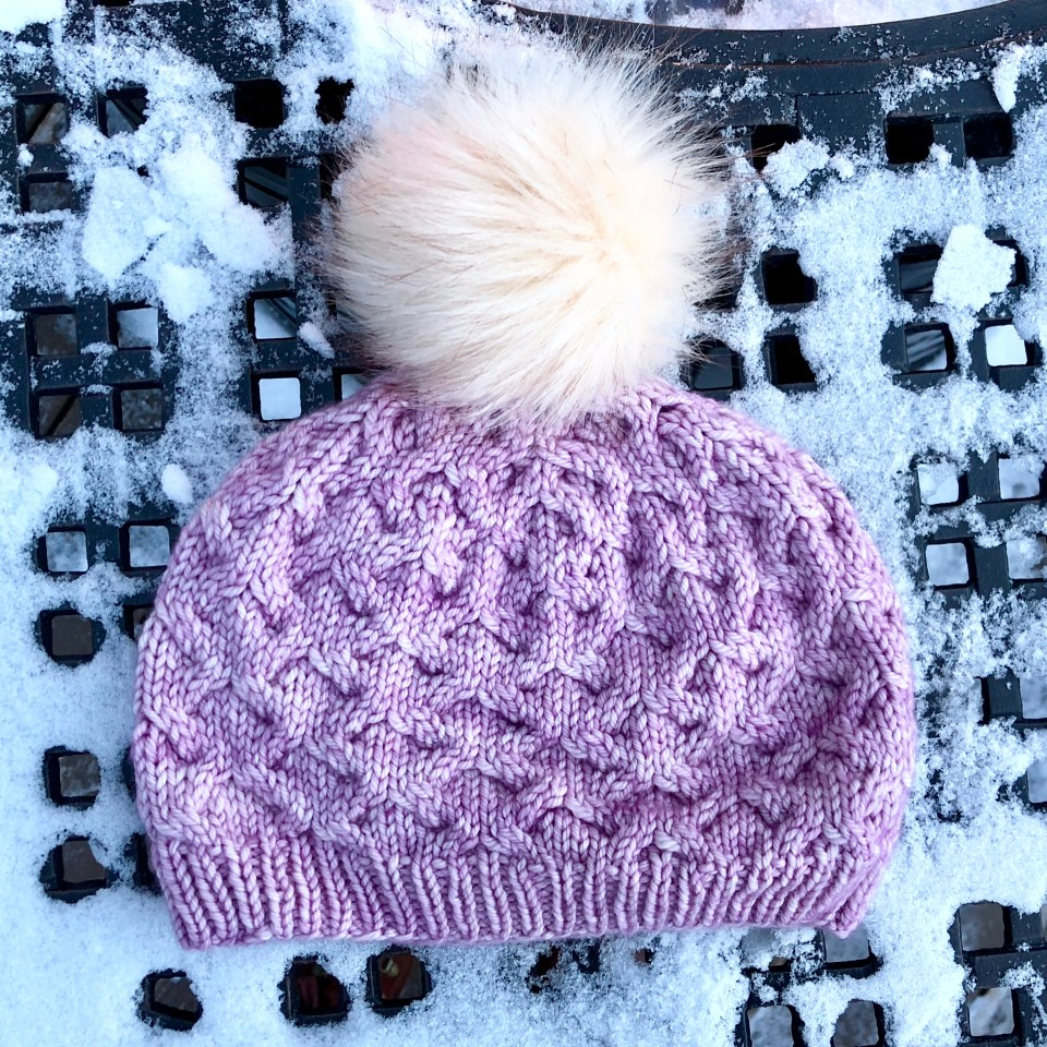 Pink Astrophil hat with cream colored pompom