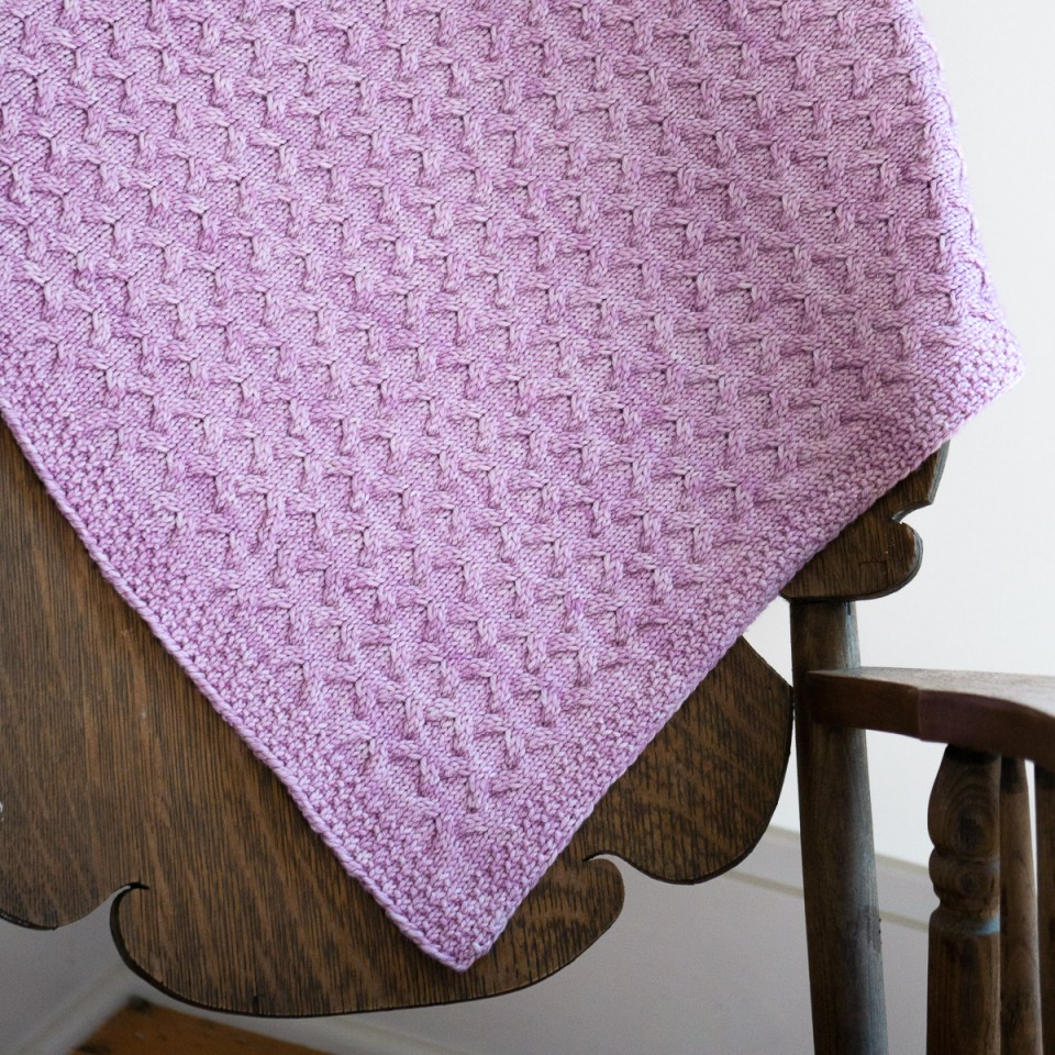 A pink worsted weight Astrophil Blanket.