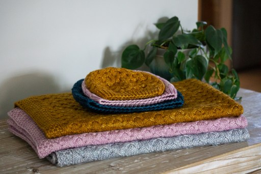 Three Astrophil Hats on top of three Astrophil Blankets.